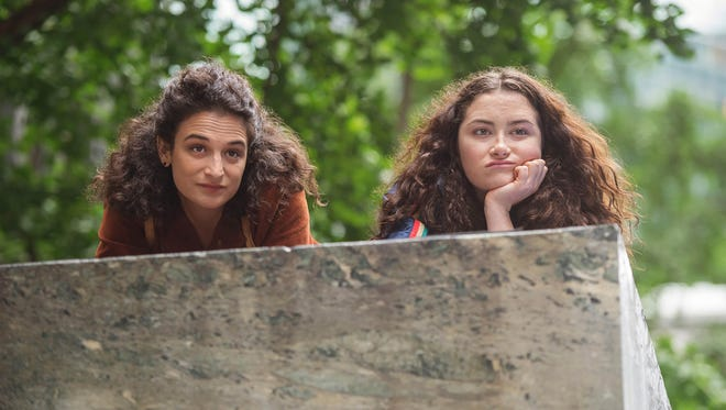 Donna (Jenny Slate, left) and Ali (Abby Quinn) spy on their possibly adulterous father in 'Landline.'