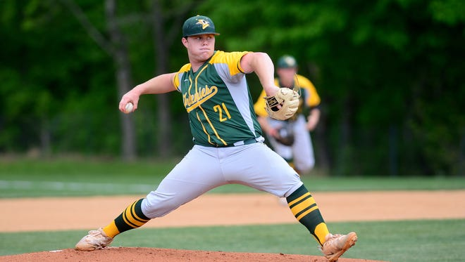 Christ School's Chad Treadway delivers a pitch during the Greenies' game against Covenant Day in the first round of the NCISAA playoffs at Christ School on Tuesday, May 8, 2018. The Greenies defeated the Lions 10-0 in five innings.