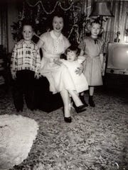 Siblings, Steven Sees, Debbie Zeitz and Eileen Holliday, shown with their mother, Gloria, at Christmas.