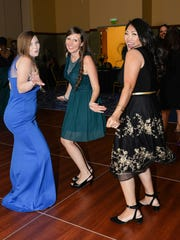 Kelly Whitten, left, Michelle Leckenbusch and Kim Marchitto dance to the music of  Next Level Entertainment at the Port St. Lucie Civic Center.