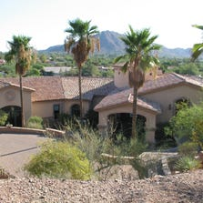 Robert Johnson paid $2.15 million in cash for this 8,479 square-foot home on the hilltop at the Sanctuary in Paradise Valley. The sale closed during the week of July 28, 2014.
