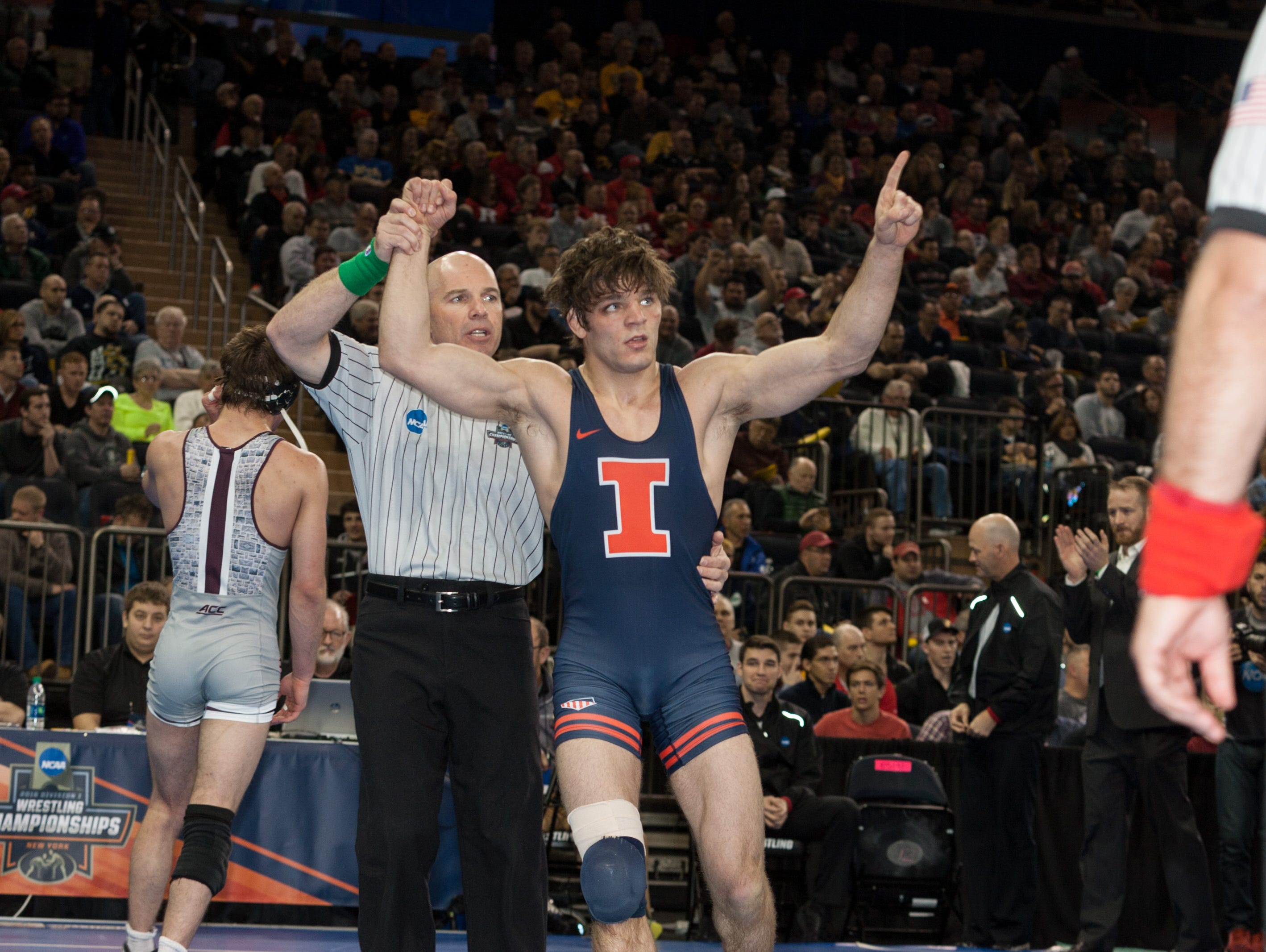 Illinois senior Steven Rodrigues reacts after winning the fifth place match at 165 pounds against Virginia Tech's David McFadden with an 8-5 decision at the NCAA Division I Wrestling Championships at Madison Square Garden on Saturday.