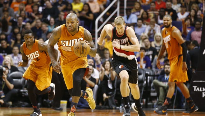 Phoenix Suns P.J. Tucker breaks towards the basket after a Suns steal against the Portland Trail Blazers during NBA action on Oct. 30, 2015 in Phoenix, Ariz.