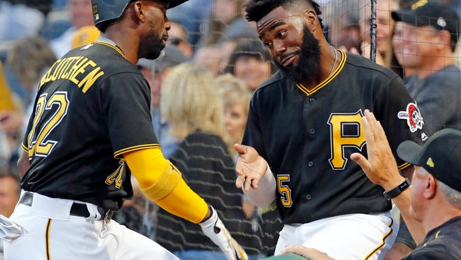Pittsburgh Pirates' Andrew McCutchen, left, celebrates with Josh Harrison (5) after hitting a solo home run off Detroit Tigers starting pitcher Matthew Boyd in the fourth inning of a baseball game in Pittsburgh, Tuesday, Aug. 8, 2017. (AP Photo/Gene J. Puskar)