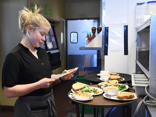 Bre Baines checks a ticket at Restaurant 415 on Friday,