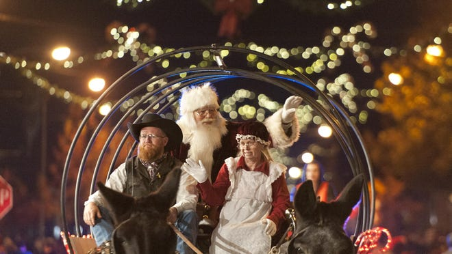 Published in print Santa Claus waves to spectators during the Candy Cane Lane parade in Visalia on Monday, December 1, 2014.