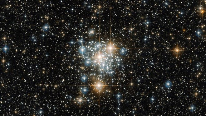 It may be famous for hosting spectacular sights such as the Tucana Dwarf Galaxy and 47 Tucanae (heic1510), the second brightest globular cluster in the night sky, but the southern constellation of Tucana (The Toucan) also possesses a variety of unsung cosmic beauties. One such beauty is NGC 299, an open star cluster located within the Small Magellanic Cloud just under 200 000 light-years away. Open clusters such as this are collections of stars weakly bound by the shackles of gravity, all of which formed from the same massive molecular cloud of gas and dust. Because of this, all the stars have the same age and composition, but vary in their mass because they formed at different positions within the cloud. This unique property not only ensures a spectacular sight when viewed through a sophisticated instrument attached to a telescope such as Hubble's Advanced Camera for Surveys, but gives astronomers a cosmic laboratory in which to study the formation and evolution of stars — a process that is thought to depend strongly on a star's mass.