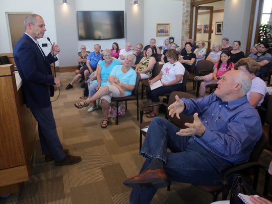 Rep. John Curtis speaks during a town hall meeting