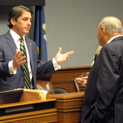House Appropriations Committee Chairman Cameron Henry, R-Metairie, left, speaks with Rep. Johnny Berthelot, R-Gonzales April 12 in Baton Rouge.