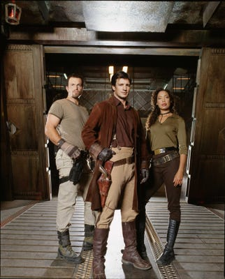 Nathan Fillion with Adam Balwin and Gina Torres in