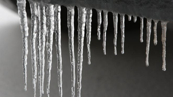 Drivers can expect a tenth of an inch of ice from freezing rain this evening.
