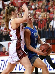 South Dakota's Jaycee Bradley, left, guards FGCU's  Stephanie Haas as she drives to the basket during the WNIT championship game at the DakotaDome in Vermillion, S.D., Saturday, April 2, 2016.