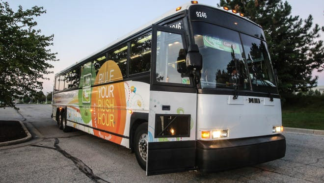 The Indy Express commuter bus, shown here in September at Carmel's Meijer store, will be shut down after Dec. 19, 2014, Central Indiana Regional Transit Authority officials say.