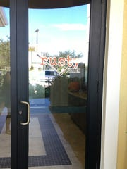 The only signage for the Rusty Putter is on the door to the restaurant in Ave Maria.