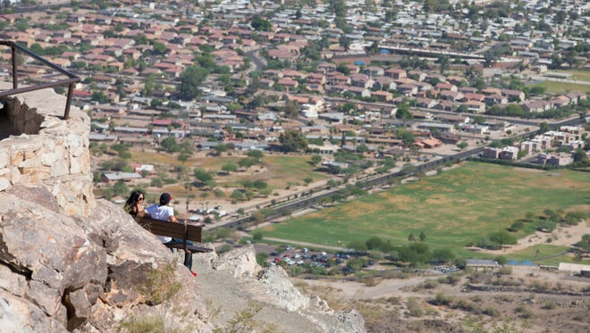 South Mountain Park in Phoenix is the largest municipal park in the United States at nearly 17,000 acres. Zahira Ortega and Daniel Garcia, of Avondale, enjoy the view of the Valley from Dobbins Lookout.