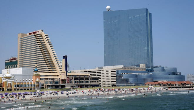 This July 23, 2014, file photo, shows the Showboat Casino Hotel, left, and the Revel Casino Hotel along the Boardwalk in Atlantic City, N.J.