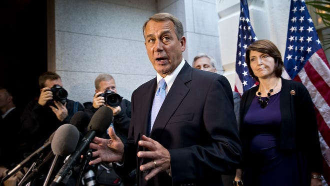 House Speaker John Boehner, R-Ohio, talks to reporters after a GOP strategy session during the government shutdown.