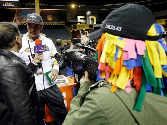 Denver Broncos' Brock Osweiler is interviewed during Opening Night for the NFL Super Bowl 50 football game Monday, Feb. 1, 2016, in San Jose, Calif. (AP Photo/Jeff Chiu)
