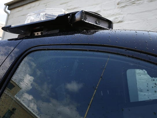 License plate scanners are fixed on top of Chemung