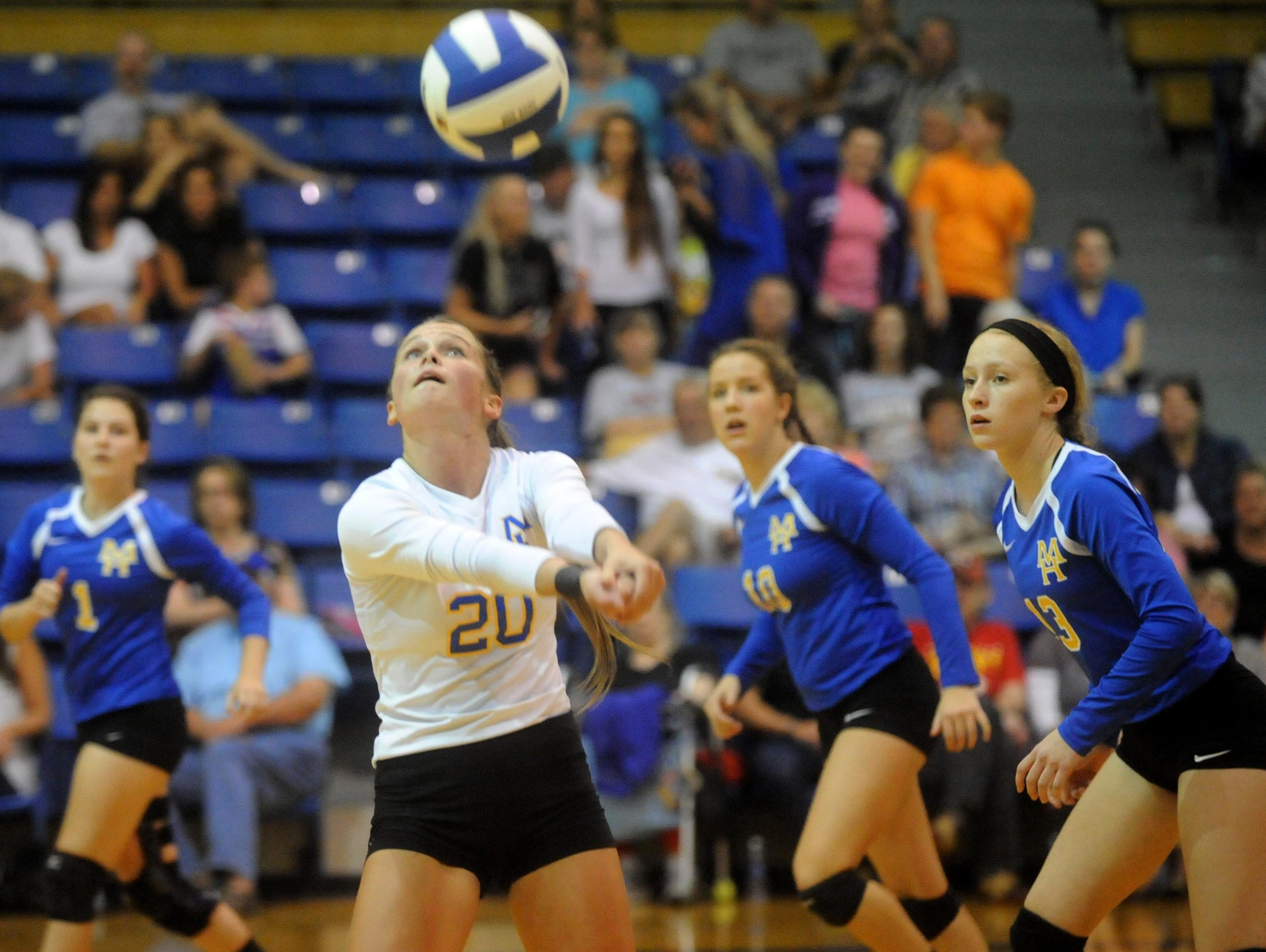 Mountain Home's McKenzie Brannon (20) makes a pass during the Lady Bombers' five-set victory over Marion on Thursday night at The Hangar. Also pictured are, from left, Ashlyn Paden, Cassie Martin and Hannah Pfeifer.