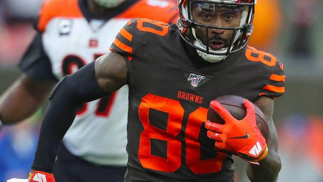 Cleveland Browns wide receiver Jarvis Landry (front) rushes for yards after a reception during the third quarter of an NFL football game against the Cincinnati Bengals at FirstEnergy Stadium, Sunday, Dec. 8, 2019, in Cleveland, Ohio.