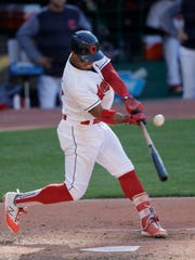 Cleveland Indians' Francisco Lindor hits an RBI-single in the sixth inning of a baseball game against the Oakland Athletics, Saturday, July 7, 2018, in Cleveland. Tyler Naquin scored on the play. (AP Photo/Tony Dejak)