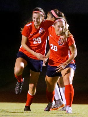 Oakland's Monica Mullaney (26) celebrates her goal against Siegel with teammate Lainey Callis (29) during a soccer game , on Thursday, Sept. 28, 2017, at Siegel.