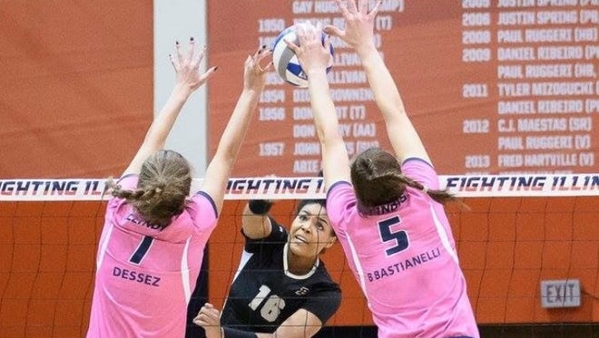 Alison Bastianelli blocks a shot for the University of Illinois volleyball team. Bastianelli has become one of the best defenders in the nation.