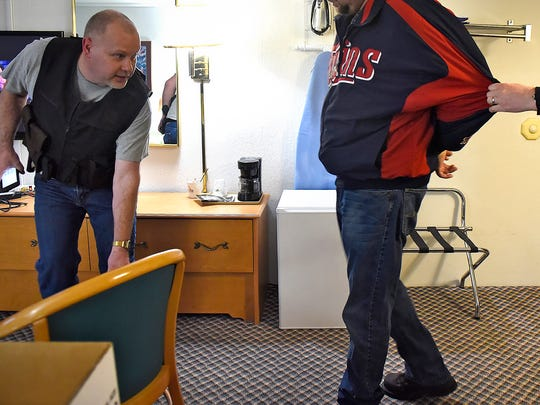 Central Minnesota Sex Trafficking Task Force member Tim Deschene prepares to interview a man arrested for soliciting a prostitute during a March 9 sting at a St. Cloud hotel.