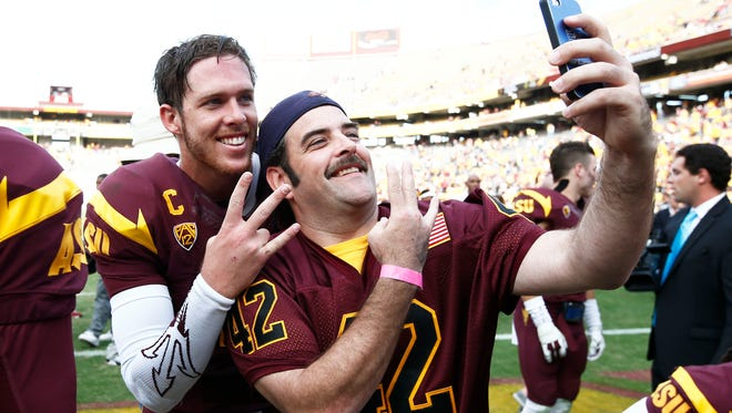 Arizona State quarterback #10 Taylor Kelly poses with fan Steven Sweeney after defeating Washington State on Saturday, Nov. 22, 2014 at Sun Devil Stadium in Tempe, AZ.