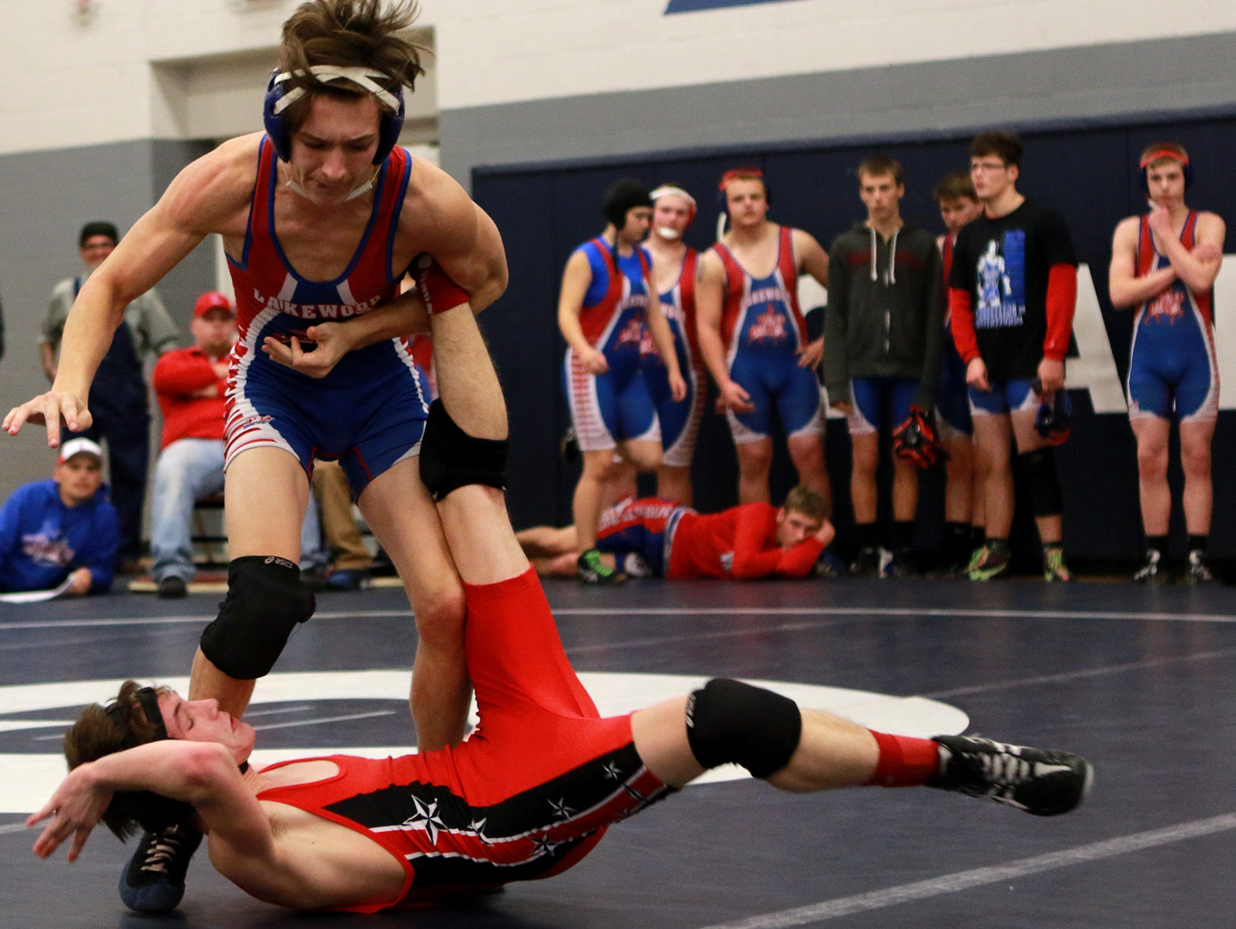 Ray Huber of Lakewood throws Matt Kuhn of Crooksville down during the Granville season opener. Huber wrestled in the 113 weight class.