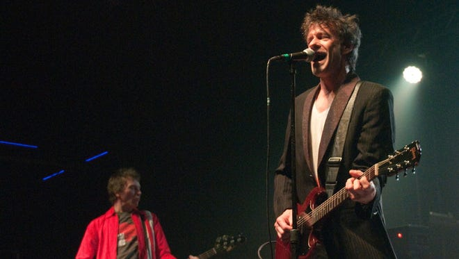 The Replacements at Echostage in Washington, D.C., on May 8. Bass player Tommy Stinson, left, and singer Paul Westerberg.