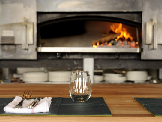 Adele's, in the Gulch, features counter top seating with a view of the wood burning oven Wednesday, July 30, 2014 in Nashville, TN.