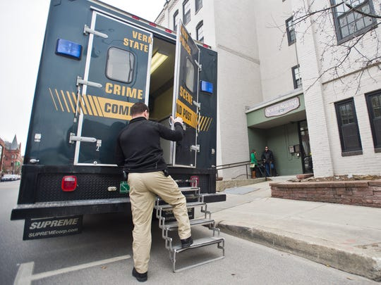 """Vermont State Police investigators work at South Square Apartments on College Street in Burlington last month following the fatal shooting of Ralph """"Phil"""" Grenon, 76, by police."""
