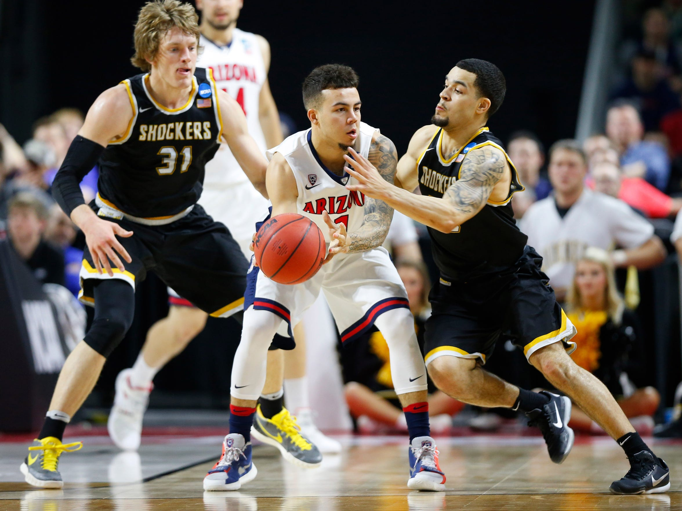 Ron Baker (31) and Fred VanVleet, right, won 121 games