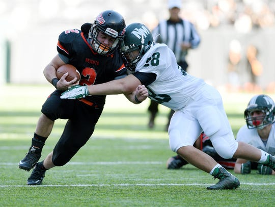 Hasbrouck Heights' John Iurato tackled by New Milford's