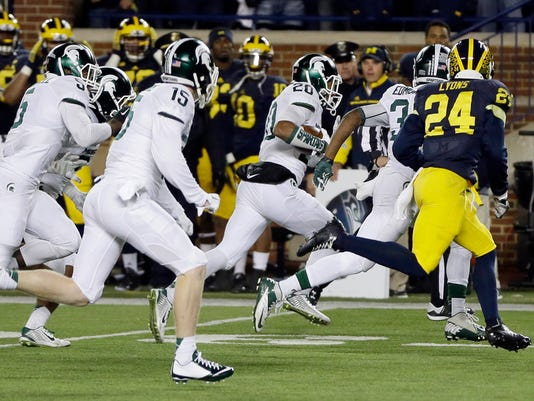"FILE - In this Oct. 17, 2015, file photo, Michigan State defensive back Jalen Watts-Jackson (20) runs toward the end zone after recovering a fumbled snap on a punt in the closing seconds of an NCAA college football game against Michigan in Ann Arbor, Mich. Watts-Jackson lumbered 38 yards for a touchdown on the final play of the game, giving No. 7 Michigan State a shocking 27-23 win. Watts-Jackson says he has requested his release from the Spartans. In a message posted on Twitter on Wednesday, March 28, 2018, Watts-Jackson said he will be graduating this year and wants to ""pursue a new program"" for his last year. He has a season of eligibility remaining. (AP Photo/Carlos Osorio, File)"