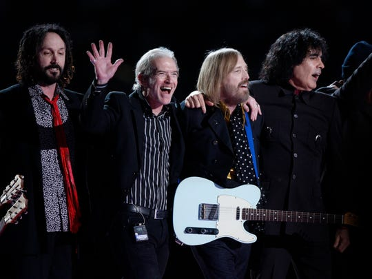 Tom Petty and the Heartbreakers wave after their performance