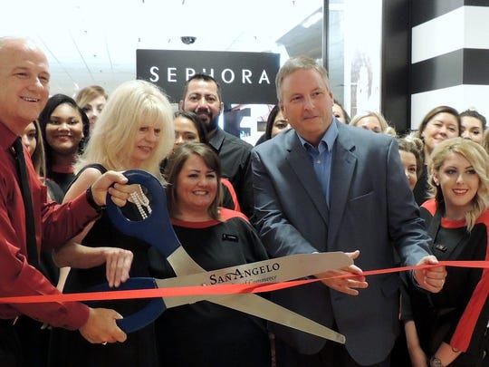 Tod Herring, left, general manager of JCPenney prepares to cut the red ribbon with San Angelo Mayor Brenda Gunter and Chamber of Commerce President Dan Koenig, during the grand opening of SEPHORA at Sunset Mall on June 23, 2017, as employees and members of the Concho Cadre look on.