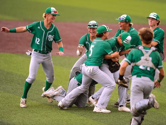 Wall players celebrate after the final out of the Hawks'