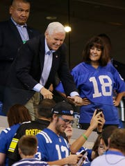 Vice President Mike Pence poses for fans before an