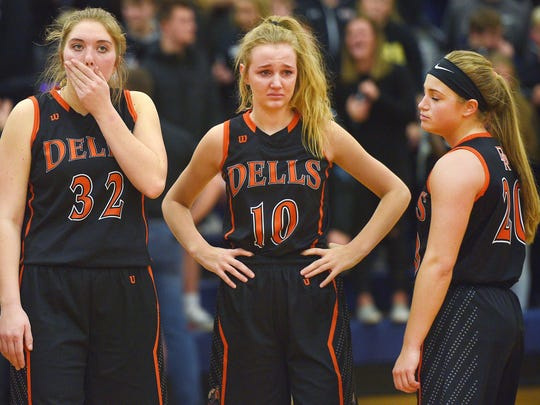 Dell Rapids' Sydney Stofferahn (32), Kyra Graham (10), and Kaylee Hennen (20) react to a loss against Vermillion last season at Tea Area High School.