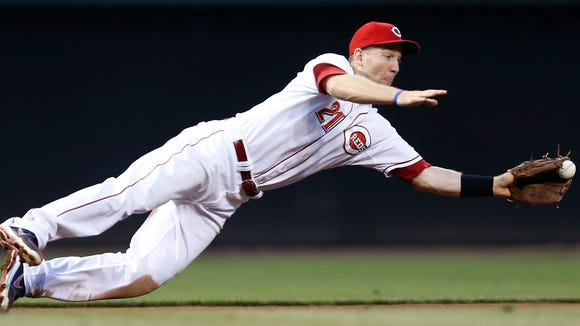 Reds third baseman Todd Frazier dives for the ball and knocks it down to make the throw for an out at first base against the Arizona Diamondbacks on July 30.