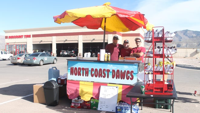 Bryan Bevire, center, opened his first hot dog stand in Alamogordo Tuesday afternoon. Bevire hopes to use to cart to participate in community benefits in Alamogordo.