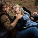 "Alex Roe, left, stars as Evan Walker and Chloe Grace Moretz as Cassie Sullivan in ""The 5th Wave."""