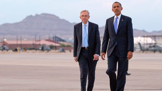 Sen. Harry Reid kept Nevada's issues at the forefront on the national dialogue. Here he walks with President Barack Obama to greet people waiting for them as they arrive in 2012 in Las Vegas.