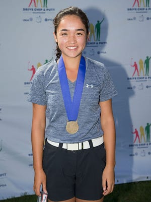Anika Dy poses at the 2015 Drive, Chip and Putt Tournament on Sept. 19, 2015, in Medinah, Ill.