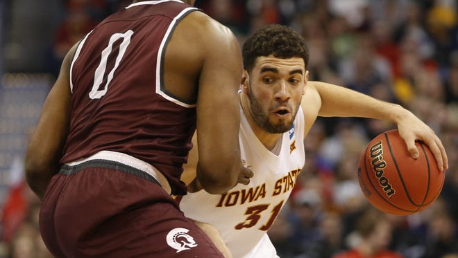 Iowa State forward Georges Niang (31) tries to push past Little Rock forward Roger Woods (0) Saturday during the second round of the NCAA Tournament.