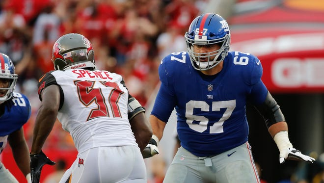Oct 1, 2017; Tampa, FL, USA; New York Giants offensive guard Justin Pugh (67) blocks as Tampa Bay Buccaneers defensive end Noah Spence (57) rushes during the second half at Raymond James Stadium.