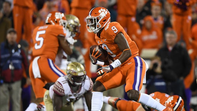 Clemson running back Travis Etienne (9) carries against Florida State during the 3rd quarter on Saturday, November 11, 2017 at Clemson's Memorial Stadium.
